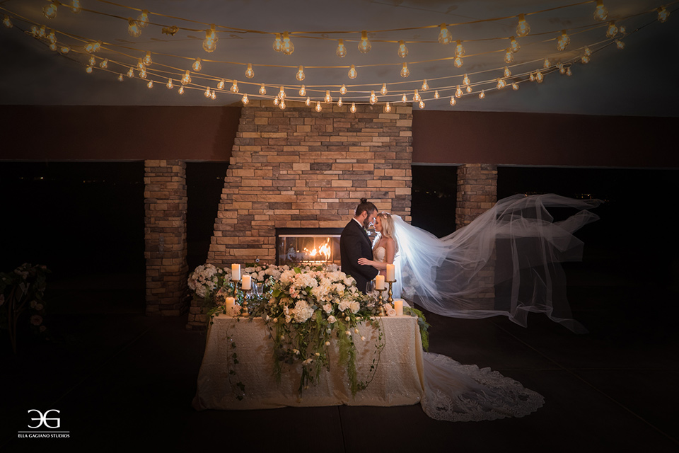Bears-Best-Venue-Wedding-Shoot-bride-and-groom-in-reception-space-bride-in-a-lace-mermaid-gown-and-groom-in-a-black-tuxedo