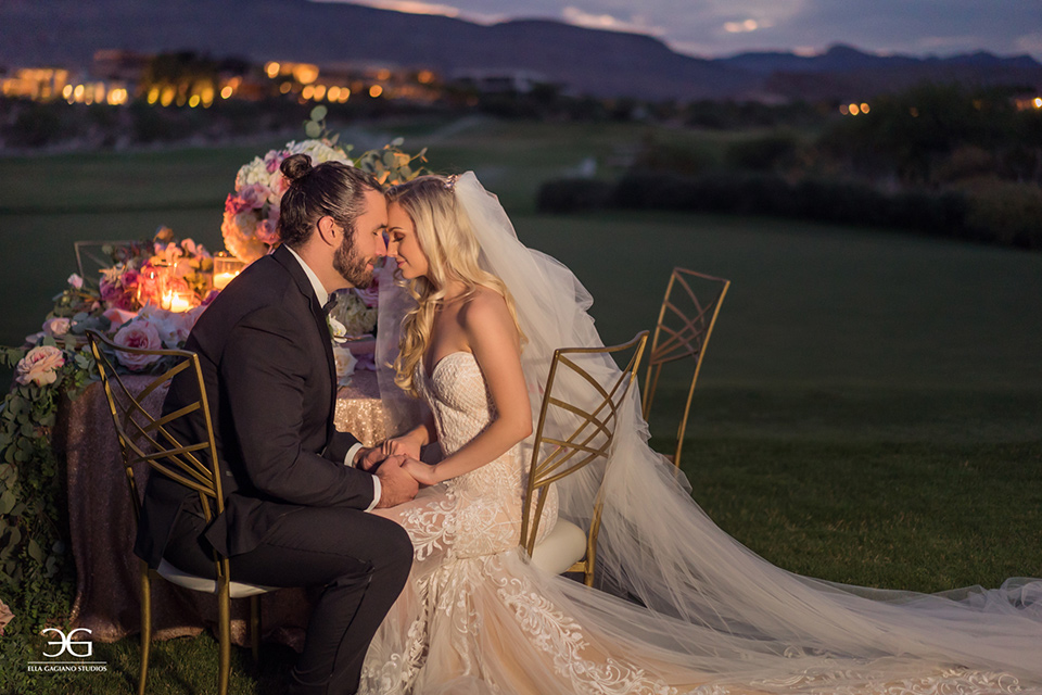 Bears-Best-Venue-Wedding-Shoot-bride-and-groom-touching-heads-sitting-at-sweetheart-table-bride-in-a-lace-mermaid-gown-and-groom-in-a-black-tuxedo