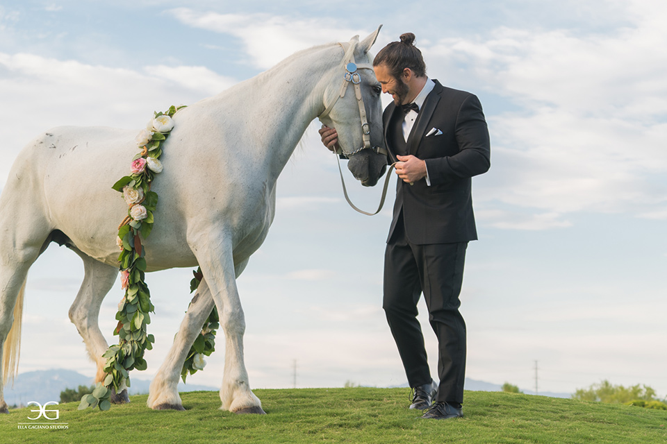 Bears-Best-Venue-Wedding-Shoot-groom-with-horse-groom-wearing-a-black-tuxedo-and-black-accessories