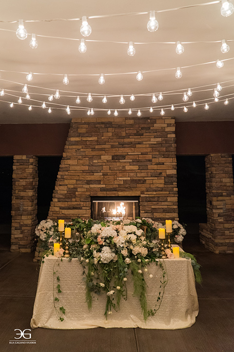 Bears-Best-Venue-Wedding-Shoot-sweetheart-table-with-white-linen-and-big-neutral-colored-roses