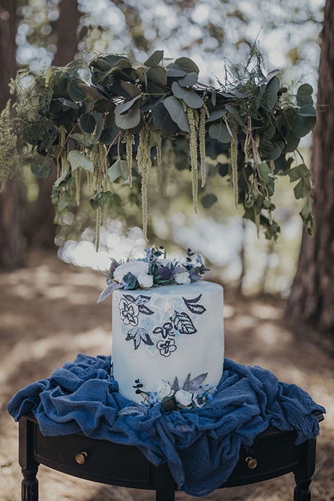 Big-Bear-Elopement-Shoot-cake-with-light-dusty-blue-fondant-and-floral-design-to-match-brides-gown