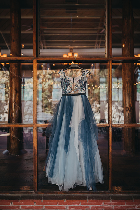 Big-Bear-Elopement-Shoot-gown-with-different-shades-of-blue-tulle-and-an-illusion-neckline-and-floral-design