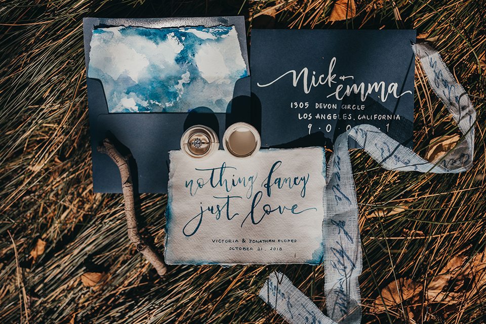 Big-Bear-Elopement-Shoot-invitations-in-different-shades-of-blue-with-calligraphy