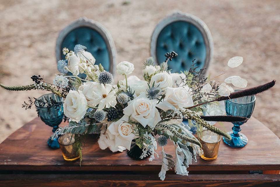 Big-Bear-Elopement-Shoot-table-setup-with-blue-velvet-chairs-and-a-wooden-table