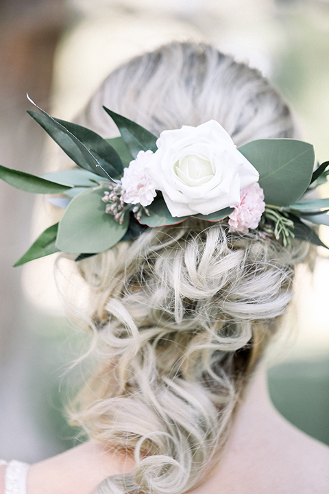 Bridal hair in a loose braid with flowers in it