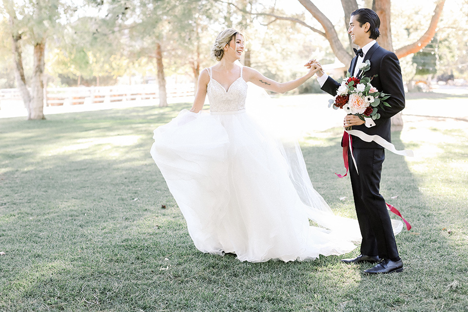 Bride and groom running in the ranch