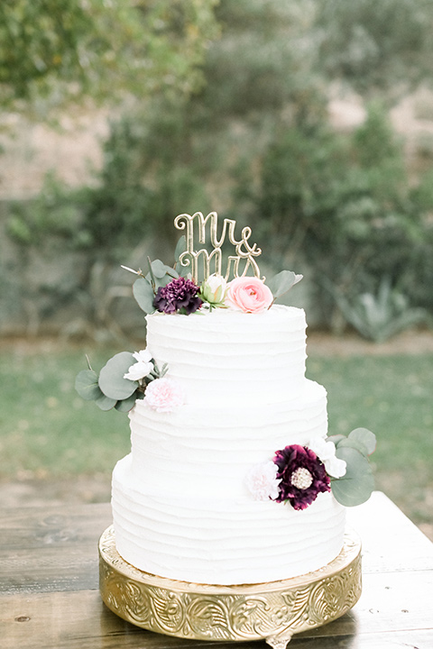 wedding cake in white fondant and simple flower decor