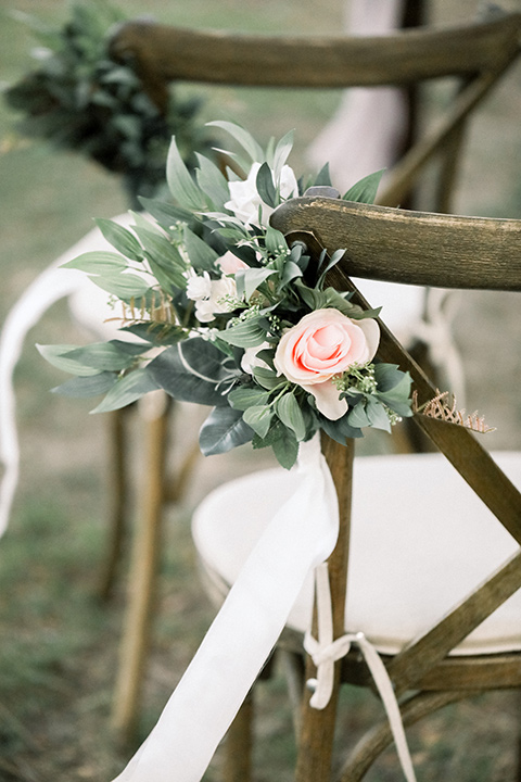 Blomgren Ranch Wedding ceremony wooden chairs with simple white florals