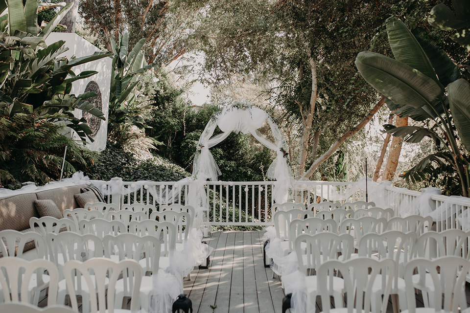 West-Hollywood-Wedding-ceremony-set-up-with-white-chairs-and-white-archway