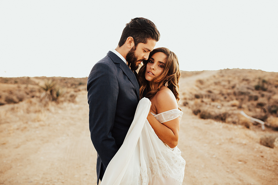 Bride and groom pose for a wedding photo in Joshua Tree