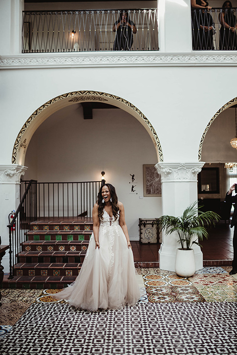 The-Ebell-In-Long-Beach-Wedding-bride-standing-in-a-strapless-ballgown