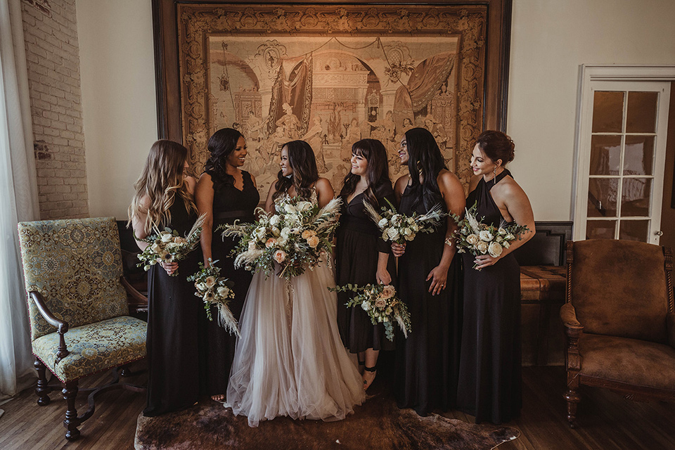 The-Ebell-In-Long-Beach-Wedding-bridesmaids-in-long-black-dresses-and-the-bride-in-a-glamourous-strapless-ballgown