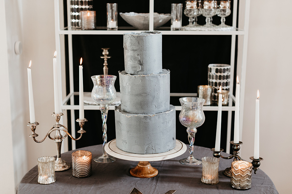 Building-177-Styled-Shoot-cake-three-tier-with-grey-fondant-and-simple-décor-surrounding-it