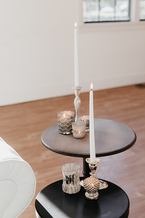 Building-177-Styled-Shoot-candles-on-coffee-table-with-tall-white-candles-and-gold-decor