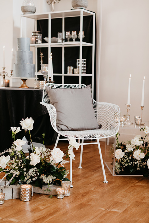 Building-177-Styled-Shoot-chairs-and-décor-in-white-and-florals-surrounding