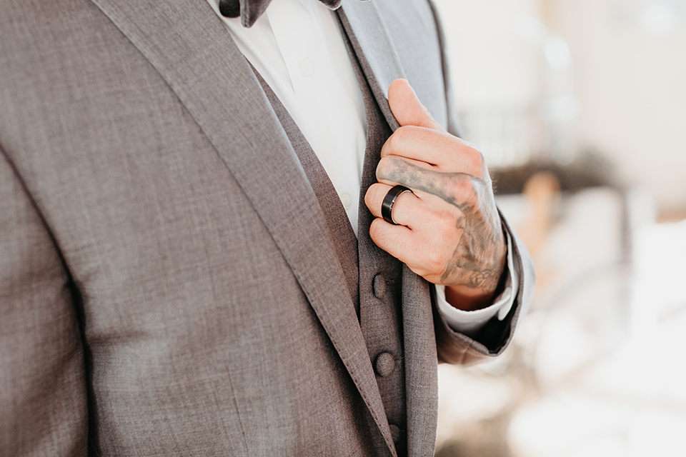 Building-177-Styled-Shoot-close-up-on-groom-attire-in-a-grey-suit-with-a-grey-velvet-bow-tie-and-black-onyx-ring