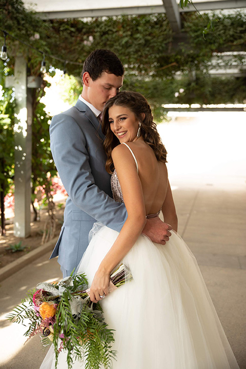 Callaway-Styled-Shoot-bride-and-groom-close-bride-in-a-tulle-ballgown-with-a-colorful-beaded-bodice-groom-in-a-light-blue-suit