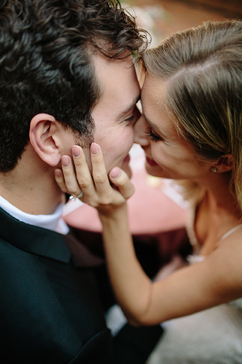 Carondelet-House-wedding-bride-and-groom-overhead-close-up-bride-in-a-lace-gown-with-an-illusion-neckline-and-thin-straps-groom-in-a-traditional-black-tuxedo-with-a-black-bow-tie