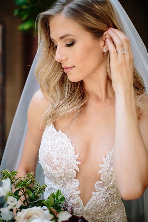 Carondelet-House-wedding-bride-close-up-in-a-lace-gown-with-an-illusion-neckline-and-thin-straps
