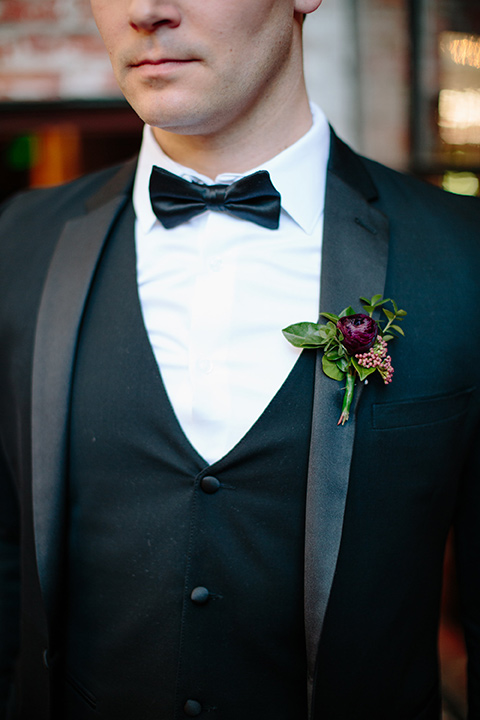 Carondelet-House-wedding-groom-attire-close-up-in-a-traditional-black-tuxedo-with-a-black-bow-tie