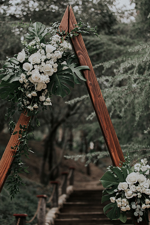 rancho-las-lomas-real-wedding-ceremony-arch-in-a-deep-wood-with-a-geometric-triangle-shape