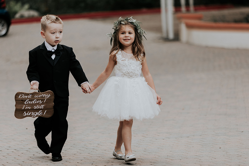 rancho-las-lomas-real-wedding-flower-girl-and-ringbarer-the-ringbarer-wore-a-black-tuxedo-with-black-bow-tie-the-flower-girl-wore-a-white-tulle-dress