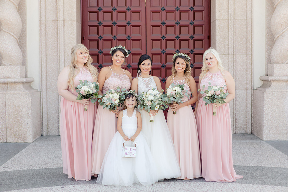 kellogg-house-pomona-wedding-bridesmaids-the-bridesmaids-are-in-pink-toned-gowns-bride-in-a-mermaid-style-gown-with-a-high-neckline