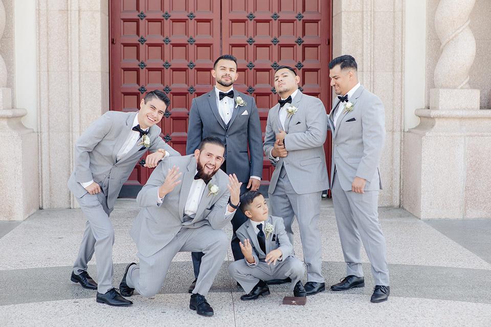 kellogg-house-pomona-wedding-groomsmen-the-groomsmen-in-light-grey-suits-and-the-groom-in-a-dark-grey-tuxedo