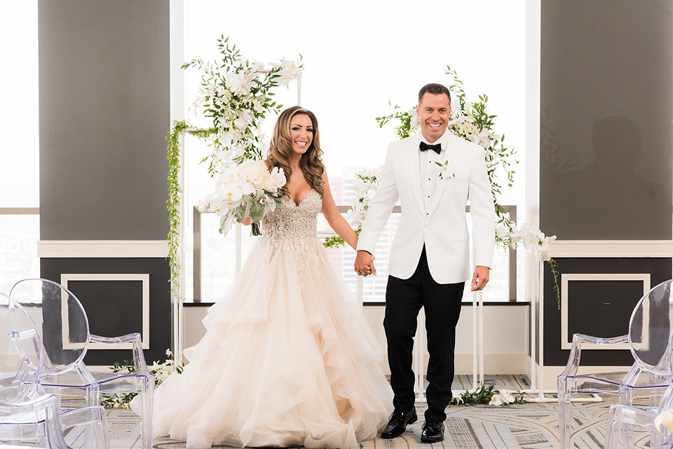 City-club-shoot-bride-and-groom-after-ceremony-bride-in-a-white-ballgown-with-a-sweetheart-neckline-and-straps-groom-in-a-white-coat-with-black-pants