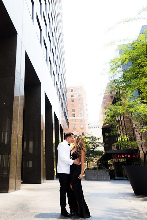 City-club-shoot-bride-and-groom-outside-venue-bride-in-a-white-ballgown-with-straps-and-a-sweetheart-neckling-groom-in-a-white-coat-with-black-pants
