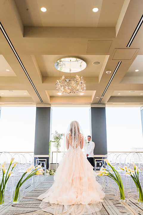 City-club-shoot-bride-facing-windows-in-a-white-ballgown-with-a-sweetheart-neckline