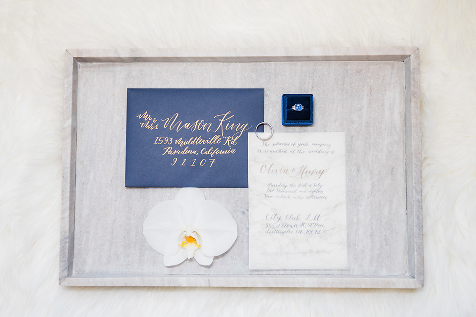 City-club-shoot-invitations-with-white-paper-and-navy-lettering-and-blue-envelopes