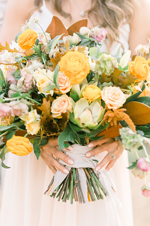 Claudia+Johns-meadow-elopement-bridal-flowers-in-deep-yellows-and-orange-tones