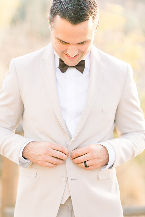 Claudia+Johns-meadow-elopement-groom-fixing-jacket
