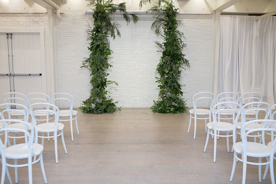 Cooks-Chapel-Shoot-ceremony-set-up-with-draping-green-garlands-and-white-chairs