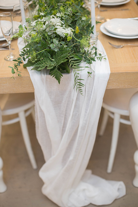 """""""Cooks-Chapel-Shoot-linens-in-soft-flowing-white-with-green-décor-elements"""""""