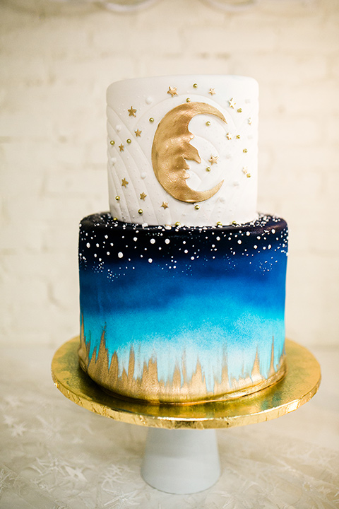 Wedding cake with blue, gold, and white celestial decor