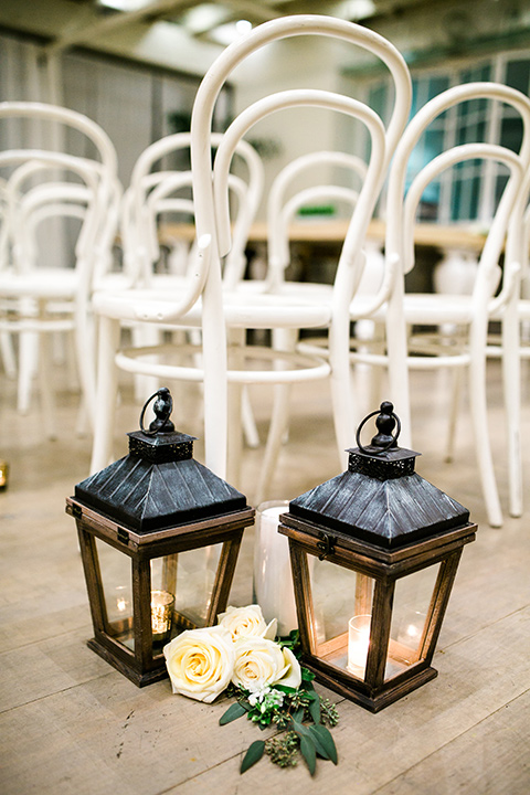 Cooks-Chapel-Wedding-ceremony-décor-with-black-iron-lanters-and-white-metal-chairs