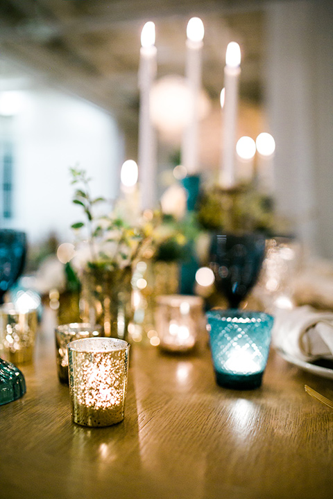 Cooks chapel wedding table decor and candles in gold and blue hues