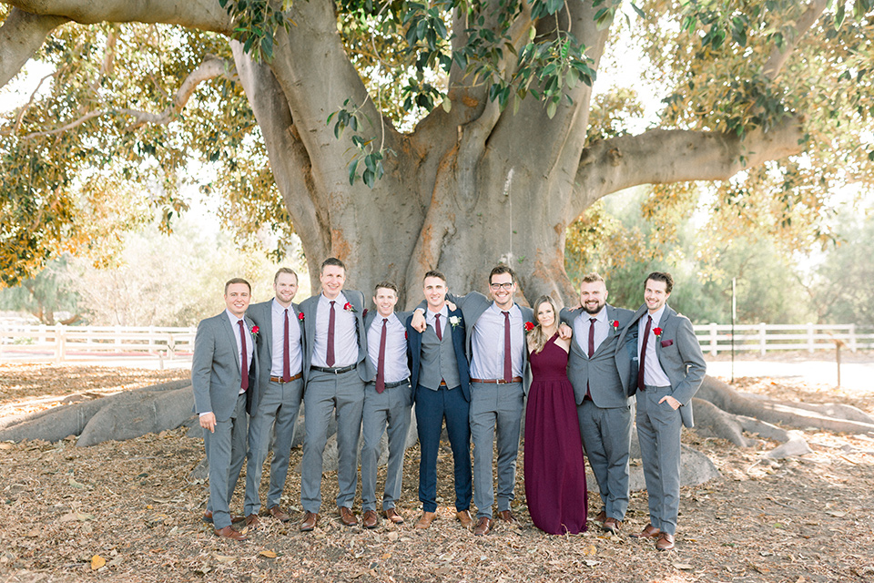 red-barn-wedding-groomsmen-groomsmen-in-grey-suits-groom-in-a-blue-suit