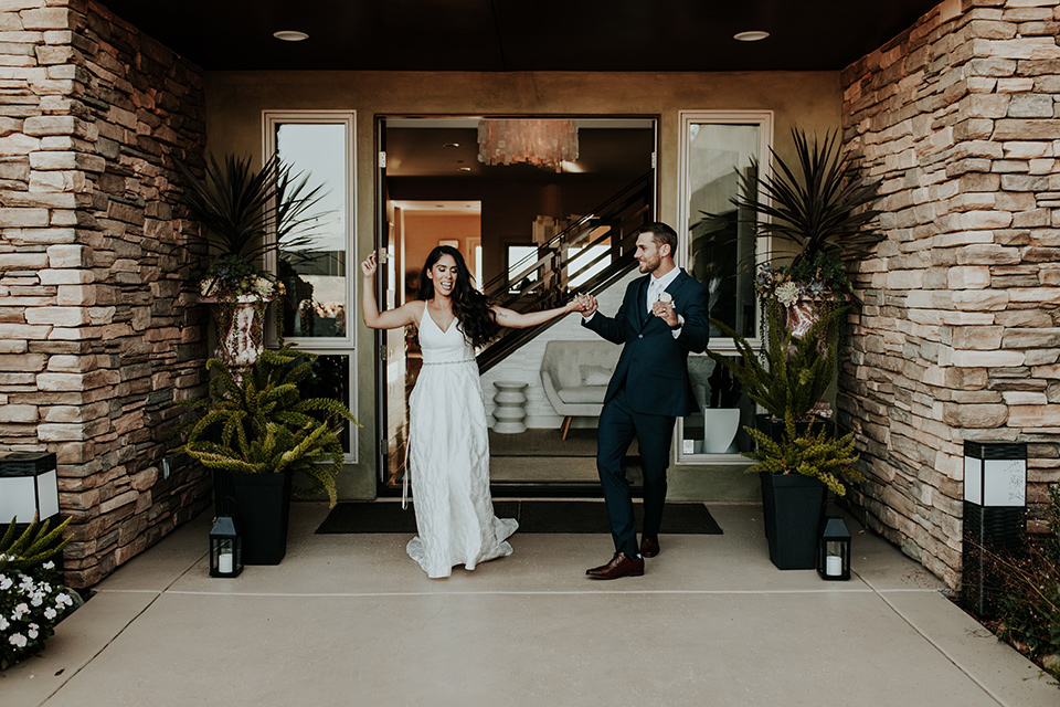 Dragon-point-villa-wedding-bride-and-groom-dancing-bride-in-a-white-ballgown-with-pockets-and-thin-straps-groom-in-a-black-suit-with-a-white-tie