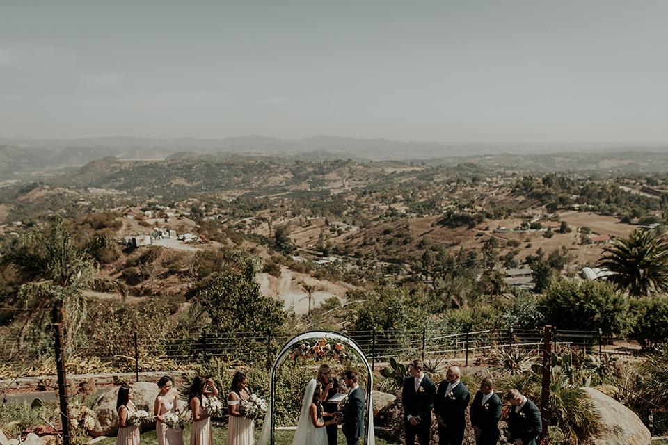 Dragon-point-villa-wedding-overlooking-ceremony