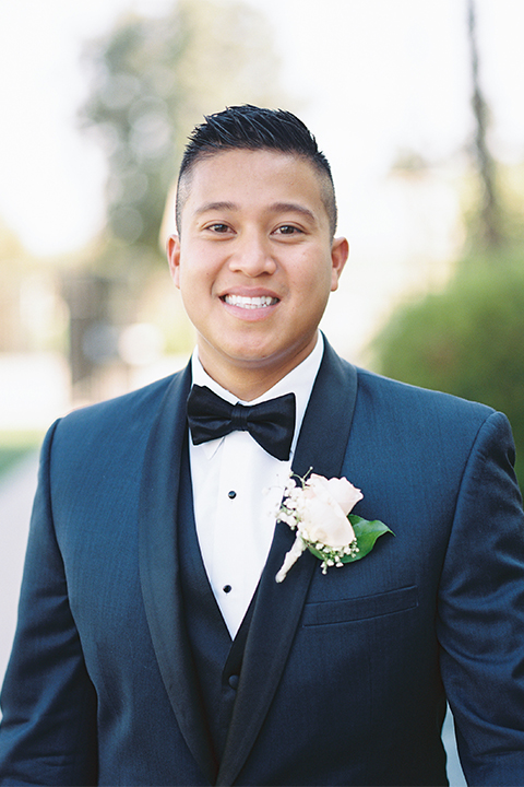Elements-Venue-presents-wedding-groom-close-up-in-a-navy-shawl-lapel-tuxedo-with-a-black-bow-tie