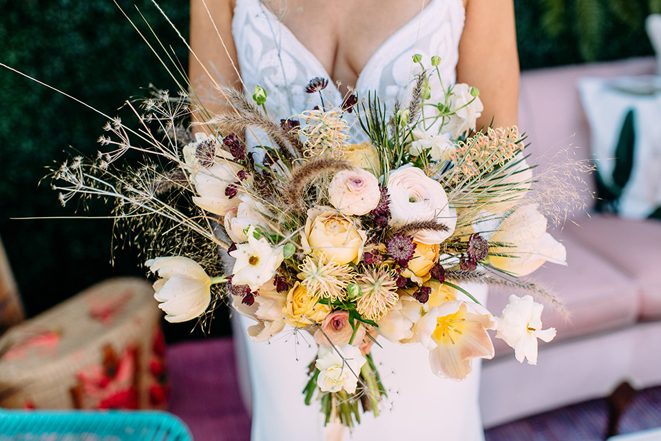 Disco style wedding bridal florals in white and yellow colors