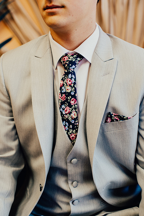 sundrop vintage photo shot grey suit with floral tie