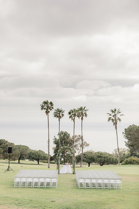 Los-Verdes-Golf-Course-Wedding-ceremony-set-up-with-white-chairs-and-white-ceremony-arch