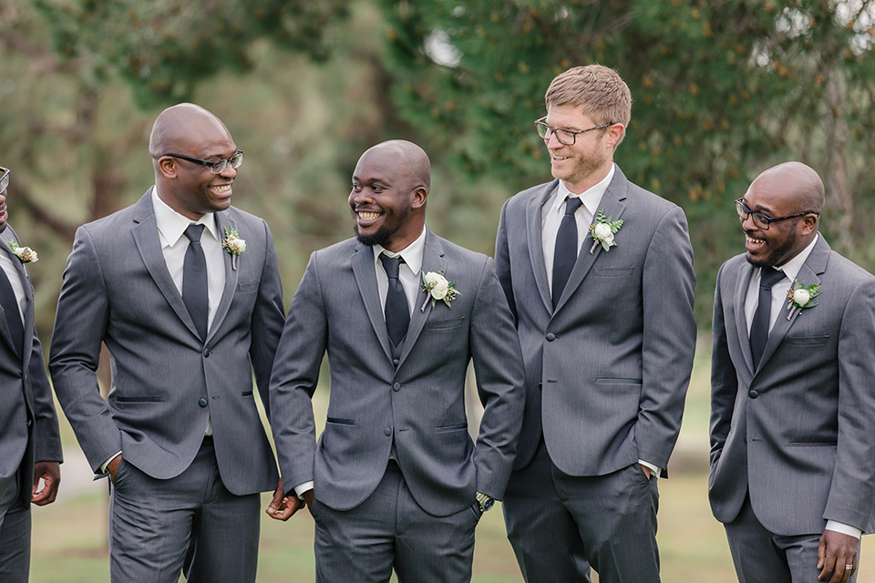 Los-Verdes-Golf-Course-Wedding-groomsmen-close-up-a-charcoal-tuxedo-with-a-black-tie