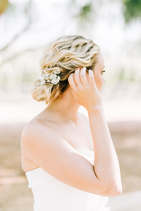 bride in a white strapless ballgown with her hair in a bun