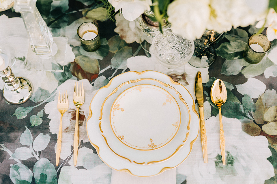 floral linen and white flatware and decor