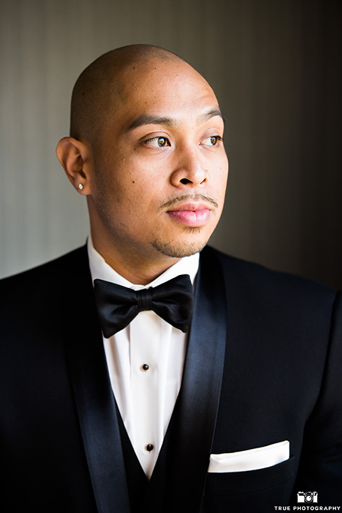 San-Diego-Wedding-groom-in-a-black-tuxedo-with-a-black-bow-tie